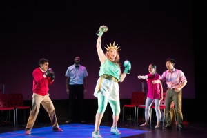 Gil Perez-Abraham (left), Shakina Nayfack (center), and the cast of Manuel Versus the Statue of Liberty. Photo by Shira Friedman