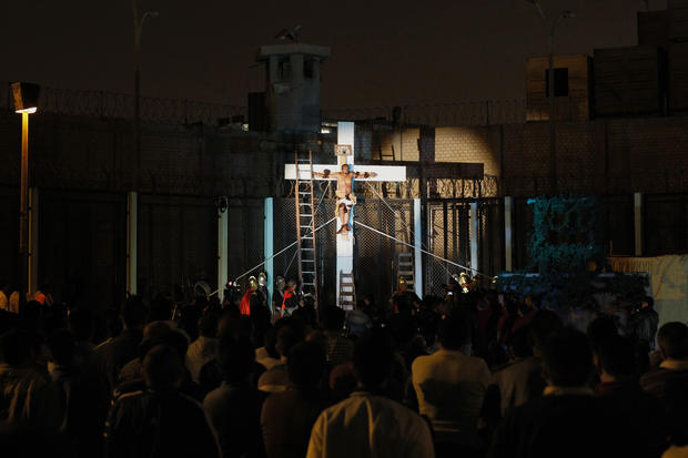 "An inmate depicting Jesus performs the crucifixion scene in the theatre play ""Jesus Christ Superstar"" at Sarita Colonia prison yard, in Lima"